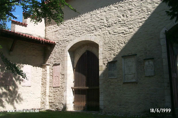 Catholic church yard, detail of the front wall, und the smaller of two gates